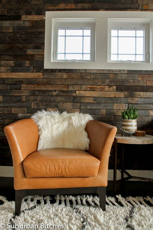Souk Wool Rug + Stikwood Wall + Tulip Leather Chairs + Bone Side Table from west elm