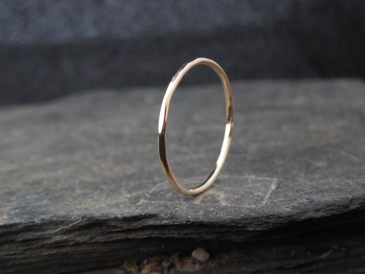 14k Gold filled ring, thin ring, hammered, made at your size.  Thin ring, 1mm thick.  Measure your fingers before buying : https://www.etsy.com/ca/listing/258787690/us-ring-sizer-multisizer-ring-size-1-17  Please choose your size in the right menu. Be certain of your size. the shop do not accept returns on custom made ring. There are going to be fees to resize a ring.  MADE TO ORDER.  What is Gold Filled Wire? Gold filled wire is made by forming a tube of gold (14k) and filling it with a…