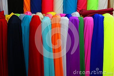 Colorful textiles scrolls - textiles of different colors vertically.