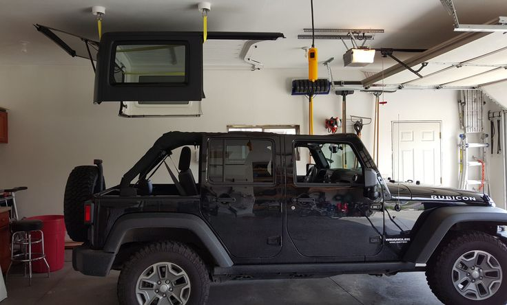 Electric Hoist And Lift Installed In Garage For Jeep