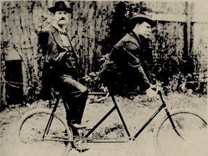 Eli Bowen (legless) and Charles Tripp (armless). A truly candid shot of these two circus friends as they rode off on a bike they found while attending a promotional photo shoot in the late 1800s. Happily the photographer was there to capture this great pic!
