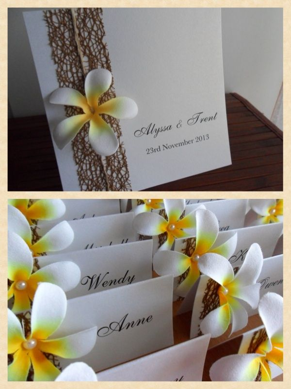 Frangipani wedding invitations and matching frangipani place cards perfect for a beach wedding.