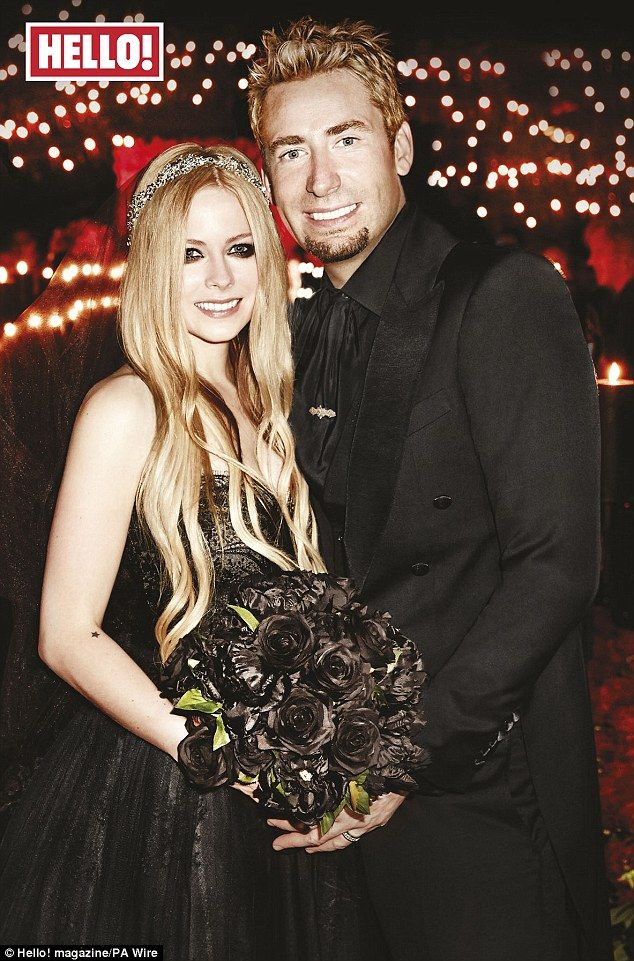 Nice day for a Goth wedding! Avril Lavigne and her new husband Chad Kroeger on their wedding day last week