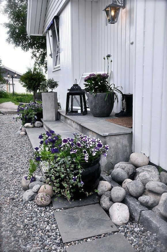 Rock garden area with gravel walkway. Could do something like this around the front deck.