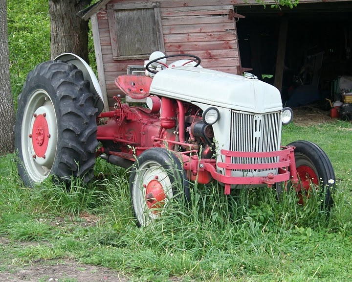 "Old Ford tractor...40+ years ago I started to learn to drive on one just like this. I could even reach the pedals, I fell off and was run over, I ruptured the tire once and half the calcium ran out and almost rolled it over on top of me once. It's called, ""Growing up"" on the farm..."