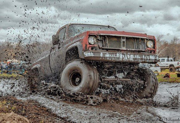 Square body Chevy kicking up mud 383 cid with 500 HP, with a old school four speed manual trans