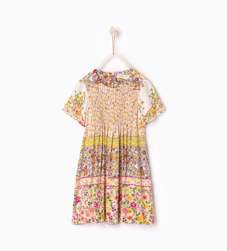 Imagem 1 de Vestido flores e rebordo decorativo da Zara