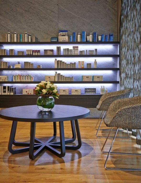 A Touch of Beauty salon interior with feature product gallery wall. Interior design by Enoki