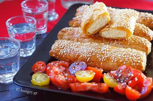 Tyropita (cheese pies) with sesame