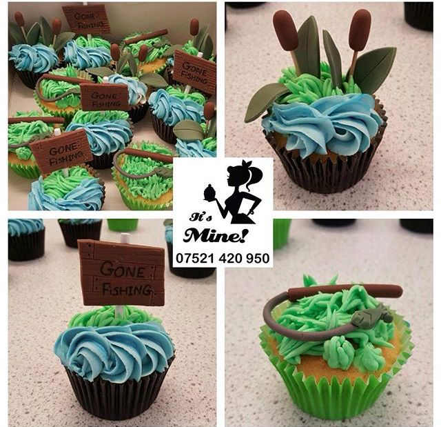 "Green and blue fishing cupcakes with fishing rods, Typha plants and ""Gone Fishing"" signs by It's Mine Cakes"
