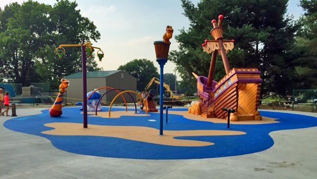 Thinking about installing a splash pad for your park or residence?  Plan now for the upcoming spring!  The City of Robinson, Illinois has a beautiful, new splash pad.  No Fault Sport Group partnered with Spear Corporation to install our No Fault Safety Surface in stunning colors of blue and tan for Pelican Cove Splash Pad!  See more at http://nofault.com/blog/project-spotlight-pelican-cove-splash-pad
