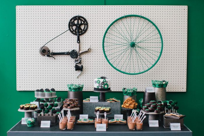 """Brilliant """"Geared Up"""" for 40 Party. 40 Backdrop is made out of Bike Gear!"""