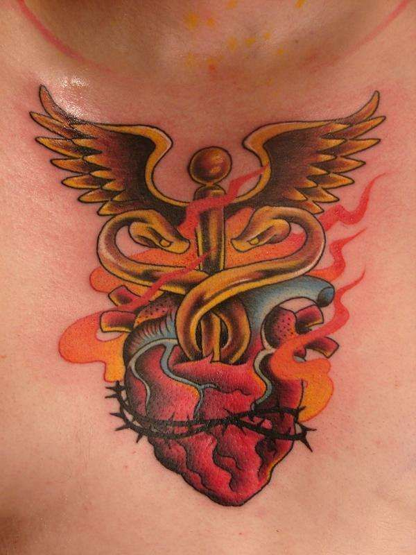 replace the snakes and the wings with a cross and it would be the perfect sacred heart tattoo for me