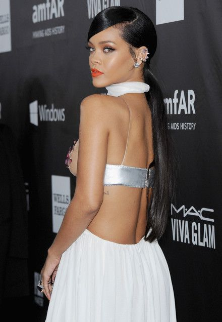 Rihanna's gala-ready metallic lids, crimson lips, and low ponytail.