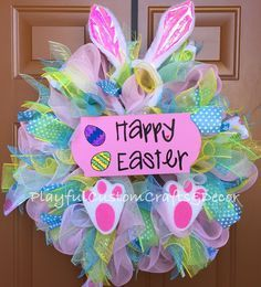 "This fun and charming Happy Easter Bunny Wreath would look adorable on your front door to welcome family and friends for Easter. It is made on a 14"" frame and measures about 24"" across. This wreath ha"