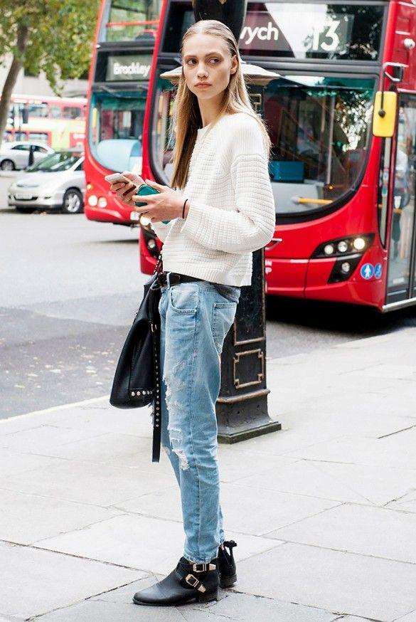 Boyfriend jeans and white sweater.
