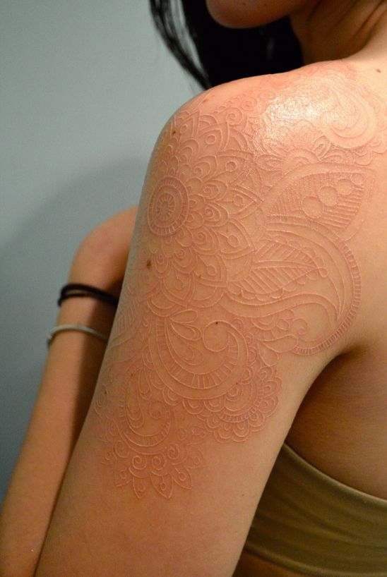 It's not really white. Blends perfectly with the skin tone!!!I want a skin tone tattoo ssooo bad.I don't think I can sit thru one this big.It sure is gorgeous tho