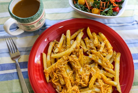 This vegan poutine recipe swaps out a beefy gravy for a veg version, and nondairy cheddar shreds for the curds. It's a guilty pleasure that's so good!