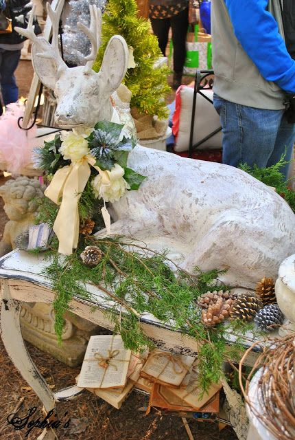 Darling cement deer with pine cones and greenery Sophia's: Country Living Fair & Shopping in Atlanta