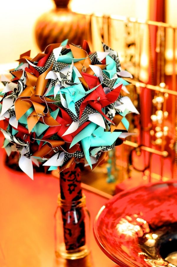 I love this idea, but need to change it to our colors. -=- Pinwheel Bouquet. Photo by Justine Johnson Photography