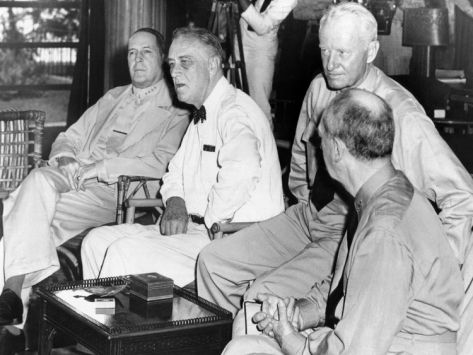 President Franklin Roosevelt at Pearl Harbor, Hawaii, on June 11, 1944. L-R: General Douglas Mac Arthur; President Roosevelt; Admiral Chester Nimitz; and Admiral William Taft Leahy.