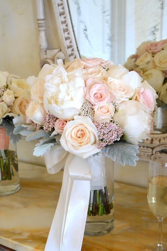 Pretty bouquet consisting of blush Roses, ivory Peonies, Rice Flower and Dusty Miller | by Gavita Flora