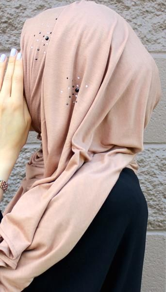 Tan Luxury Jersey Hijab Embellished w/Swarovski Crystals We use ONLY high quality Swarovski crystals Perfect for dressy outfit, weddings, and Eid celebrations! Material: Stretch Jersey Size: 180 x 80
