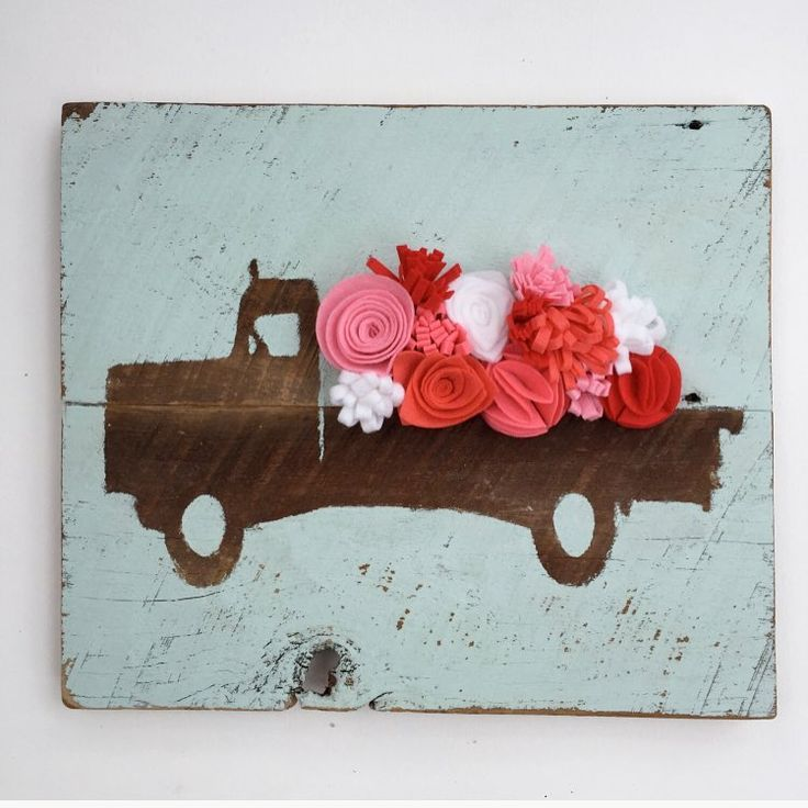 One truck with felt flowers left in our etsy shop! Boy did things go quickly this morning. Looks like we're going to need to make some more joy signs ASAP! We are blessed by your unwavering support. Thank you.