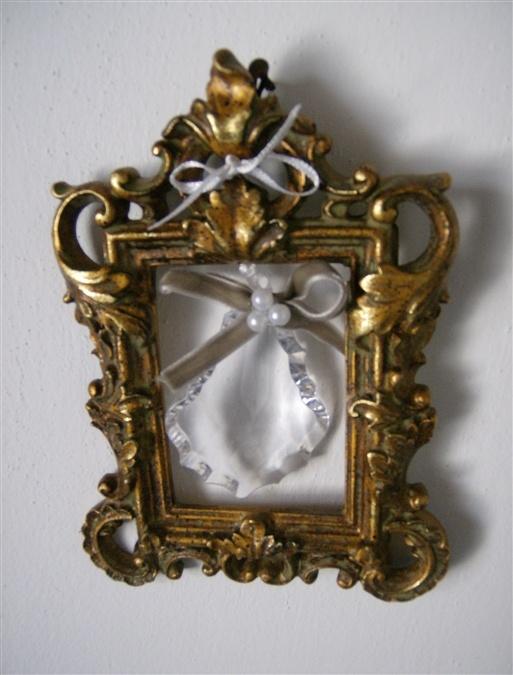 Cornice in legno intagliato e dorato con inserimento di ciondolo di cristallo.  Created by LA GATTA by Barbara Giorgi. ........... Yes, I'm.  :)