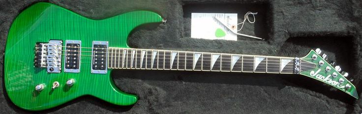 """2002 Jackson SL2H Soloist - USA Made - Quilted maple top on Alder body - Neck-thru-body Quartersawn Mahogany neck - 25.5"""" Scale - 24 jumbo frets - Ebony fingerboard - Die Cast Tuners - Mother-of-pearl shark fin position inlays - Trans green matching headstock with Jackson logo - Seymour Duncan JB TB4 Humbucker Bridge, SH-2n Neck Pickups - Master Volume, Master Tone - 3-way Pickup Switch - Floyd Rose© Original™ Double Locking 2-Point Tremolo - Chrome Hardware - Transparent Green Finish"""