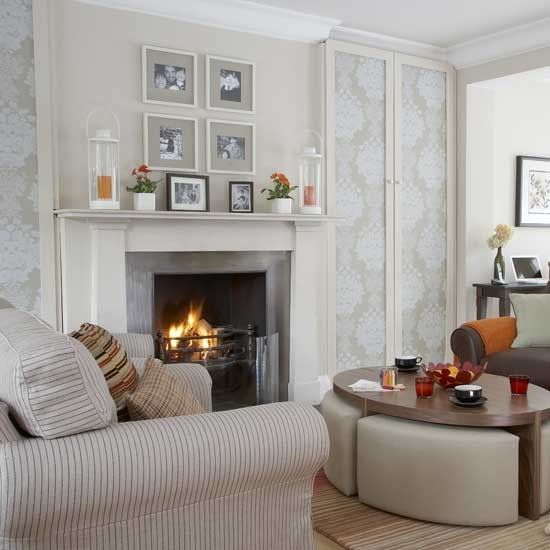 Alcove cupboards covered in wallpaper create good-looking storage for toys. Coffee-table seating is perfect for games.