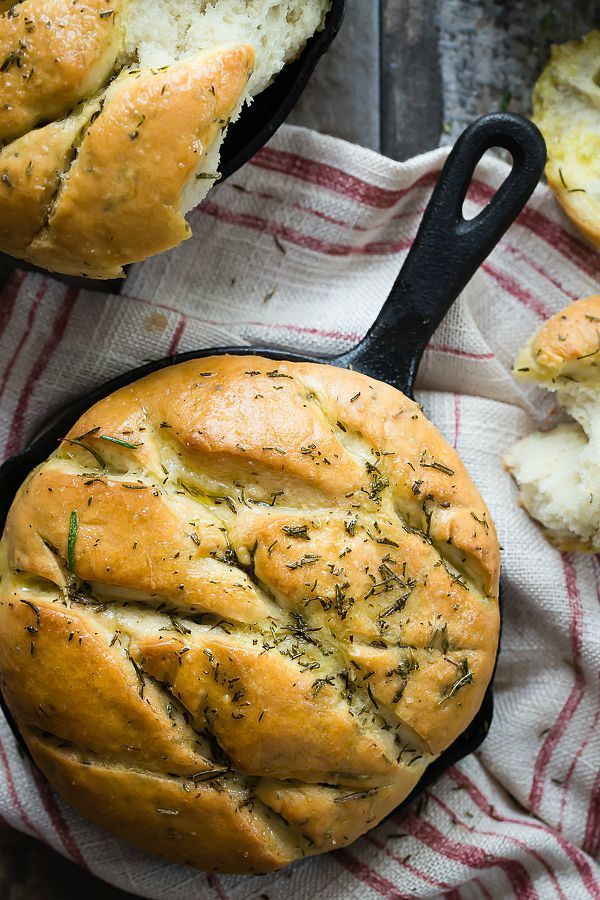 Soft and chewy easy focaccia bread topped with fresh rosemary and sea salt. This is the perfect bread to go along with some pasta or a panini sandwich.
