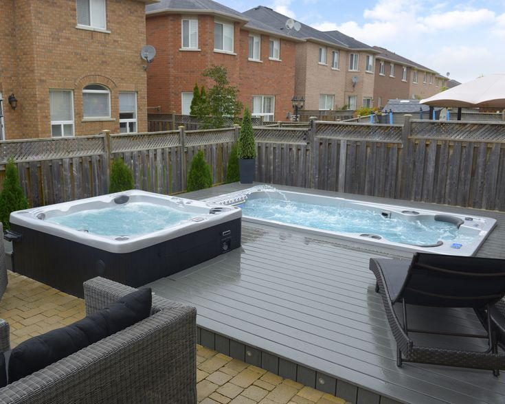 A Hydropool hot tub and self cleaning swim spa sunk into composite deck, love the two together!