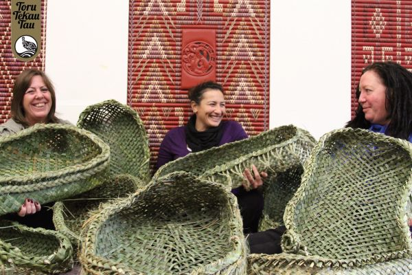 Weaving students lend a hand to weave wahakura