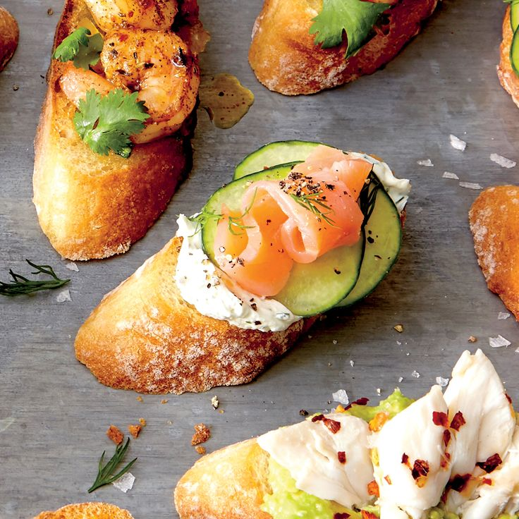 Top baked bread slices with cream cheese, cucumber, and smoked salmon to make this tasty appetizer.