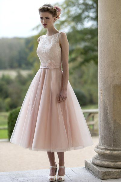 Tea length bridesmaid dress with delicate lace bodice and sheer neckline and full Tulle Fifties style skirt