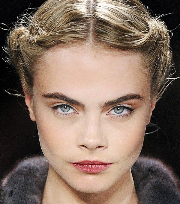 Loving Cara Delevingne's bold brows and braided updo