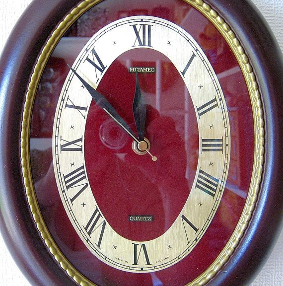 Metamec Wall Clock Oval Mahogany Recycled Battery Operated. Perhaps, perhaps, perhaps...