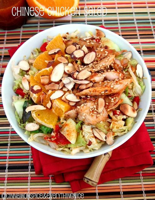 Chinese Chicken Salad | Cinnamon Spice & Everything Nice--this salad has a range of textures from the lightly sautéed cabbage to the crunchy almonds and cucumber.  Sweet and savory with the sesame chicken and oranges!