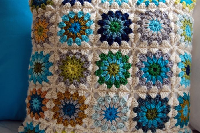 wisecraft crochet pillow. Must have. Also like it against the plain the IKEA couch.