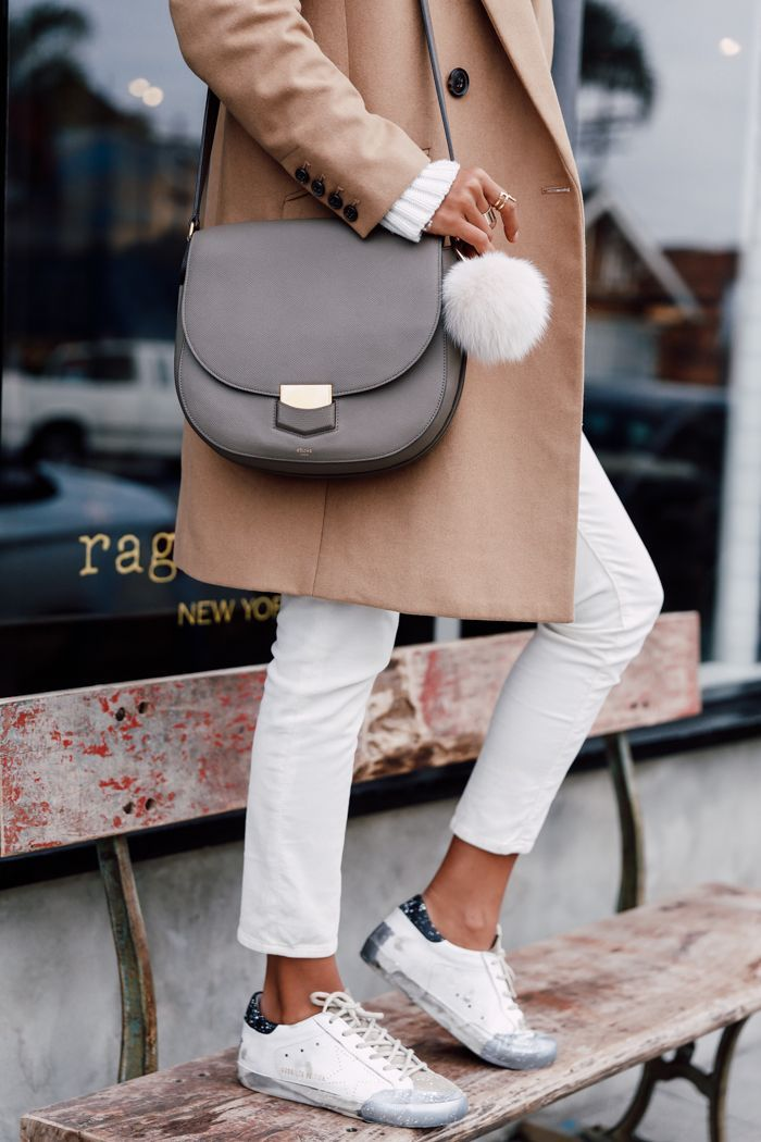 White beige sweater + camel coat + purple gray Céline shoulder bag + white skinny jeans + gel sneakers