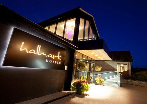 An evening exterior view of this modern style building, the Hallmark hotel in Gloucester.