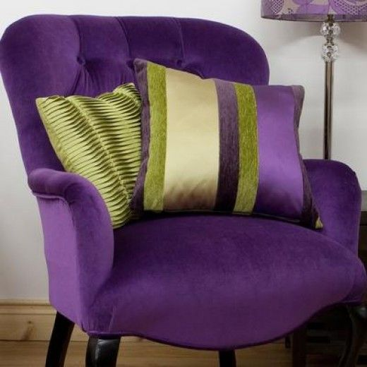 Purple furniture (chairs etc.) works if a purple wall doesn't appeal to you.