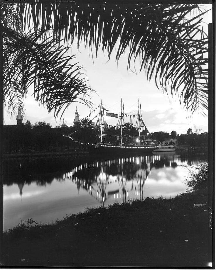 Illuminated Gasparilla XXXIV pirate ship docked at Plant Park on Hillsborough River: Tampa, Fla.  by Burgert Brothers.
