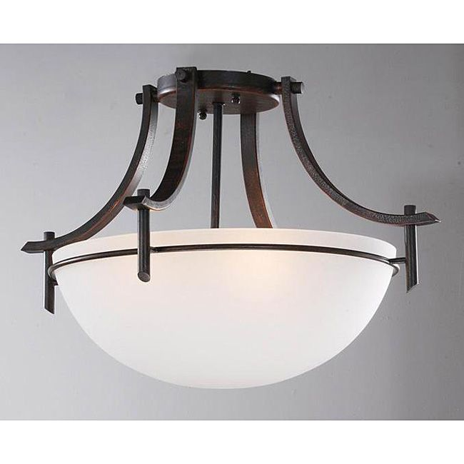 Add contemporary style to any room in your home with this handsome dark bronze three-light ceiling fixture. The ironwood frame with a dark bronze finish contrasts with the round alabaster-style white shade, adding a classic style to this fixture.