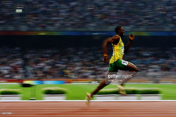 Usain Bolt of Jamaica competes on his way to breaking the world record with a time of 19.30 to win the gold medal in the Men's 200m Final at the National Stadium during Day 12 of the Beijing 2008 Olympic Games on August 20, 2008 in Beijing, China.