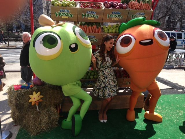 P+ mascots for King's Farm Heroes Saga hang out with Vanessa Manillo at the game's launch in NYC