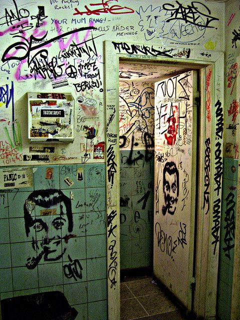 Gritty graffiti riddled bathroom.