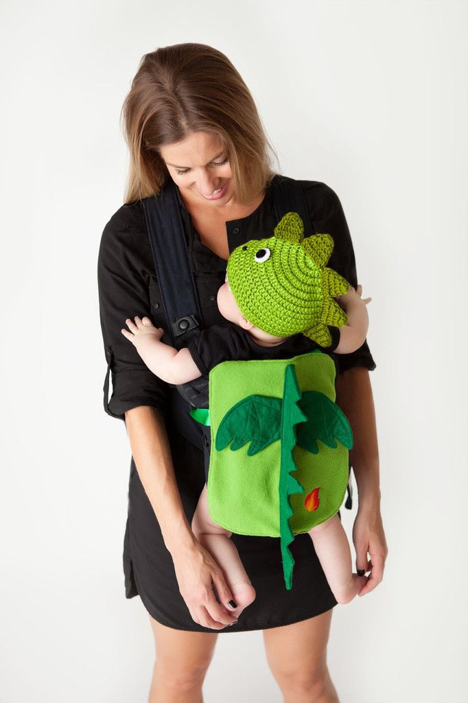 This adorable dragon costume is made of soft jersey knit with embroidered flame.  The spikes and wings are made from soft green felt. Hat is knitted from cotton yarn and dragon teeth are made from soft felt.  Bib is one size fits all.  Hats come in two sizes. S/M (0-9 months) and M/L (9+months)  Costume ideas....parent dresses up as Daenerys Targaryen from Game of Thrones....long blonde wig and a white shawl.....Done!!  You win the Halloween costume contest!!