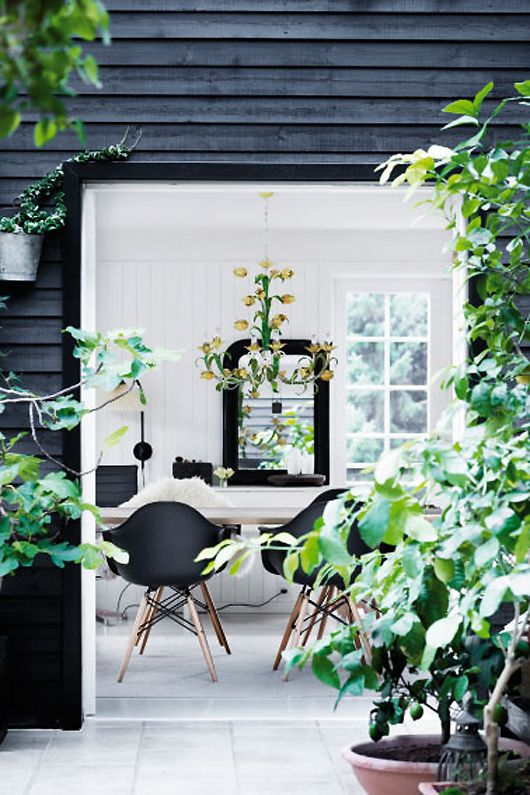black weatherboard exterior, white interior.